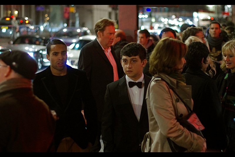 When I last photographed him at a GQ and possibly a prior Empire Awards, I had no idea who he was. I still don't. But he's the one wearing the tuxedo, not me, so I think it's clear where blame falls.  (edited to add : actor Craig Roberts?)