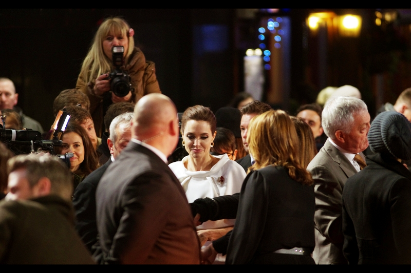 It's a $100 note but it would be unseemly to bend down and pick it up    . Director Angelina Jolie turns left and heads off to the stage to be interviewed.