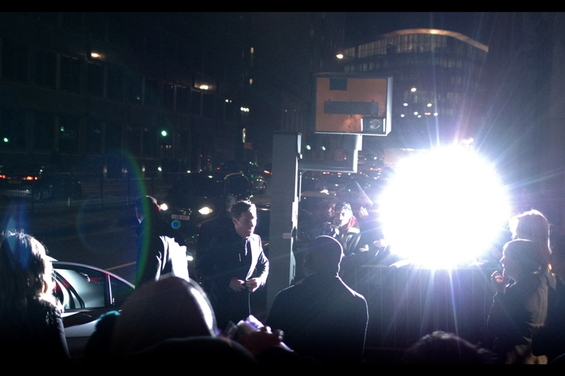 Good news for fans of wearing sunglasses at night : just hang around Benedict Cumberbatch and you can navigate by the blasts of paparazzi barrages.