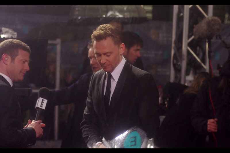 Update : Tom Hiddleston closes an umbrella. That is all.