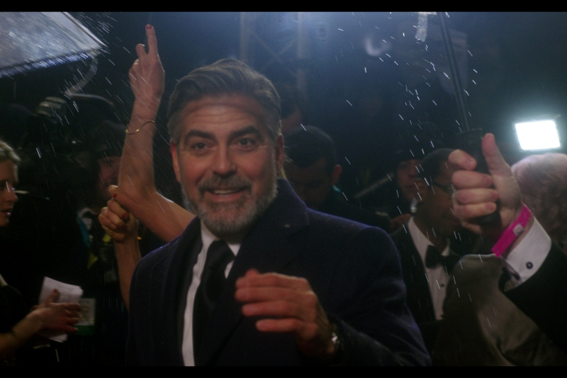 George Clooney spreads more love. Or is challenging the Big Girl next to me to an arm wrestle. Don't do it, George.