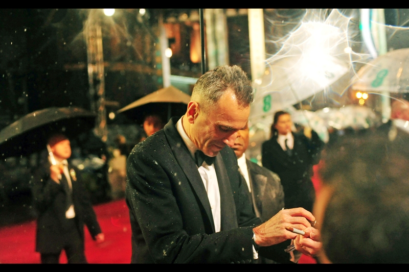 Daniel Day Lewis will sign autographs by feel. It's for a role he's working on.