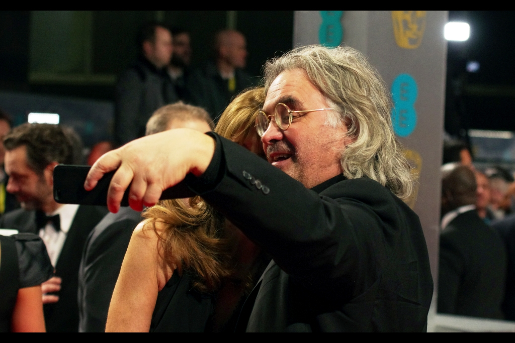 Back on the Red Carpet of the BAFTAs, Paul Greengrass takes a left-handed selfie on the red carpet in front of me. I feel kind of hurt that he didn't ask me or anyone in the crowd to take the shot..