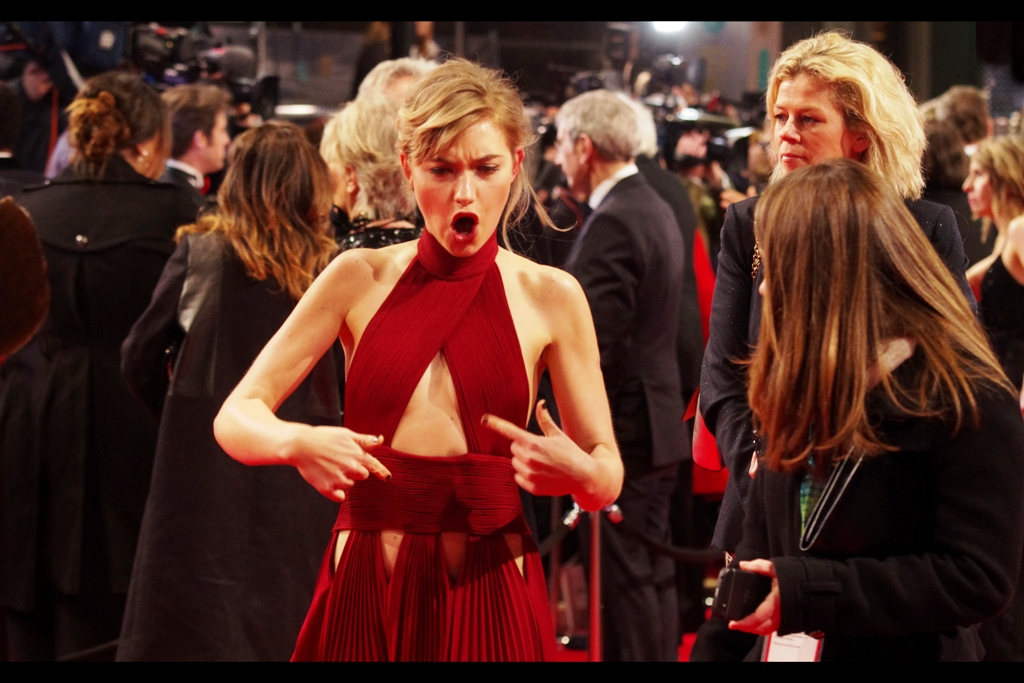 Issuing banned gang signs on a BAFTA red carpet in that dress? I'm impressed.