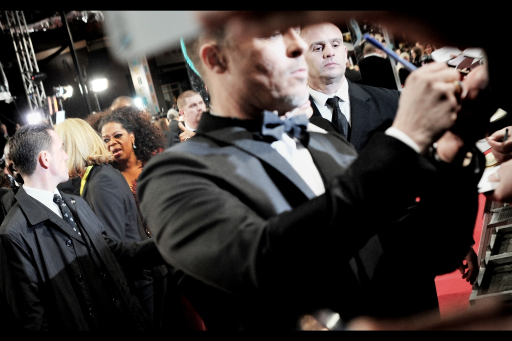 Rather incredibly, this isn't so much a bad photo of Brad Pitt as it is a very fortunate and accidental photo of Oprah Winfrey in the background!
