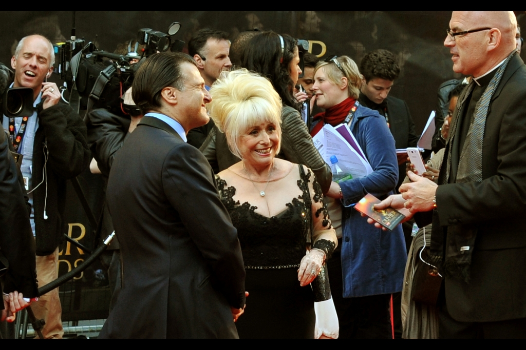 """The ladies next to me are from America and mainly here for Tom Hiddleston (?), while the ladies on the other side of me are not American but also appear to be mainly here for Tom Hiddleston. And this is obviously NOT Tom Hiddleston, but I've been reliably informed that this is Barbara Windsor, and the identification of her was forceful enough that I felt guilty asking follow-up questions (like """"who is Barbara Windsor?""""), so I didn't."""