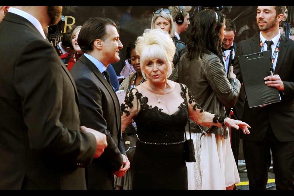 According to Wikipedia. Barbara Windsor has been in the TV show Eastenders for 20 years (1500+ episodes), and has had a theatre career that started in 1950. She was also a voice in Tim Burton's Alice In Wonderland (2010), so on balance it's probably more my fault that I don't know who she is than the other way around.