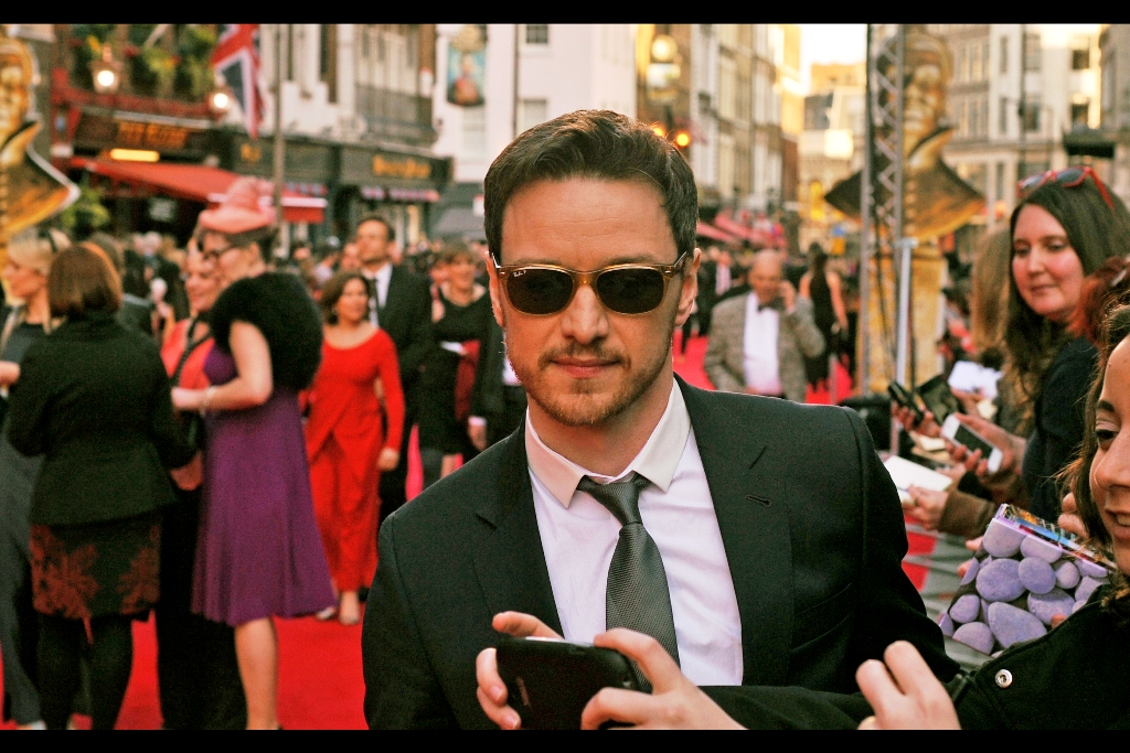 """""""Yes, that's a very impressive App all right, but are you going to take a photo of me or what?""""  James McAvoy is probably best known for playing the Patrick Stewart / younger role of Professor X in the X-Men prequels, but is apparently  fantastic in the movie Filth  which I haven't seen. His sunglasses, though, are Ray-Bans. As are mine."""