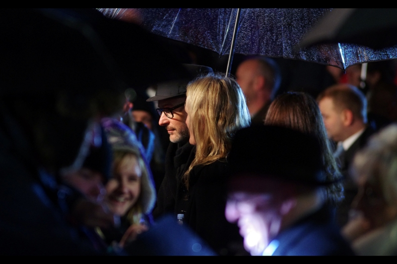 """I'm going to see if I can find a few more umbrellas just to make it even harder to photograph you"" ""Good idea""  . The Man In The Hat is director Matthew Vaughn."