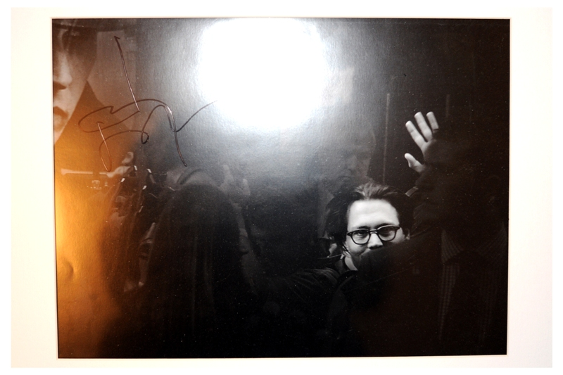 YAY! Sure it's not the best photo (and it's black and white so that artistic blue and yellow from the flash is sadly not a permanent feature of the image) but it's a Johnny Depp autograph on a photo I TOOK!  (I'm so lonely..)   Oh, and he even complimented me on it! What he said was: