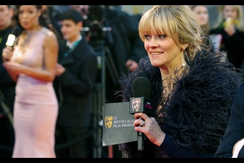 Interviewer Edith Bowman walks the carpet, flashing her branded Bafta microphone and envelope, and the dress an Ostrich was possibly drowned in dye to create.