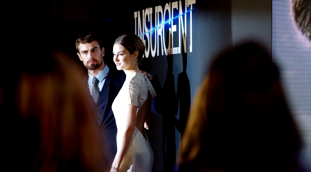 """Don't tell us we're pretty. We already know."".  Theo James and Shailene Woodley are younger than you, better looking than you, and starring in a major Hollywood franchise. I forget where this sentence was going... something about self-loathing, I supect."