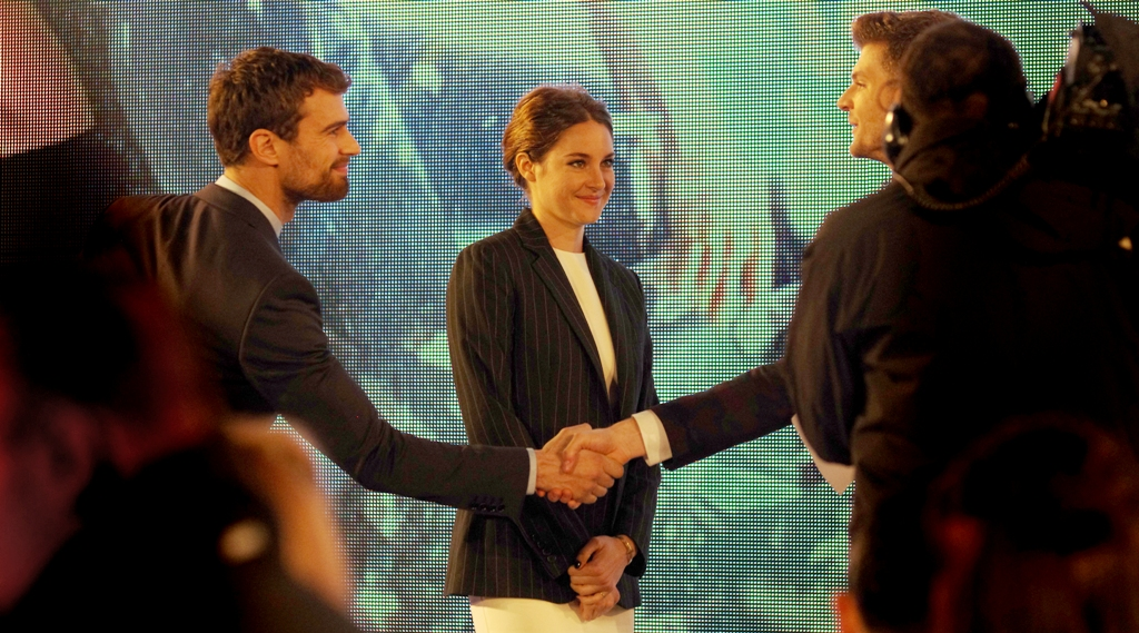 """Let's see who finds this already uncomfortably long handshake uncomfortably long first"" . My money's on Shailene."