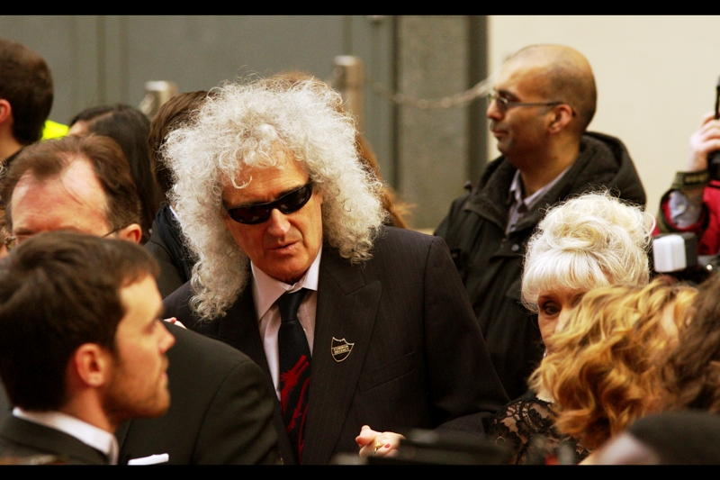 Queen bandmember Brian May's hair did eventually show up as prophecied.