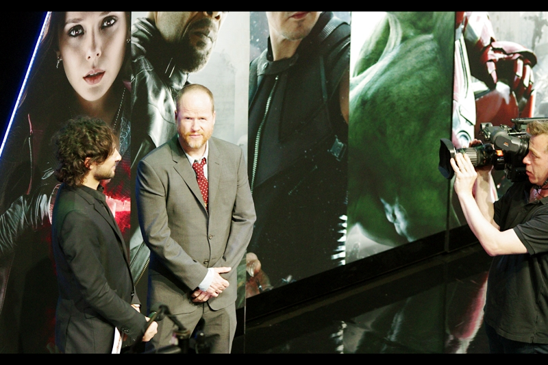 """She's coming"".  Joss Whedon has returned to stage for an interview, and he's being hit with all the important questions."