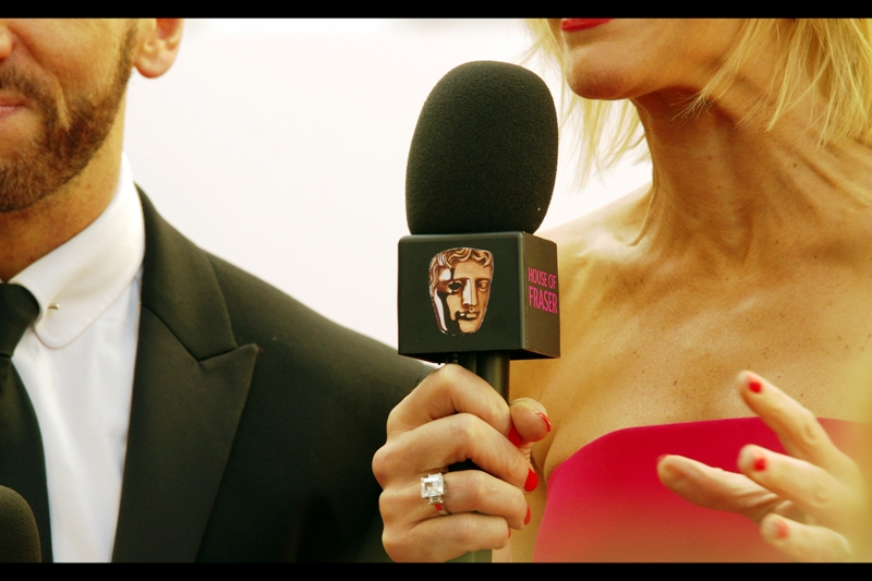 """Baffy The Bafta Head will be our corporate logo for this event. All Hail Baffy!!"".  Also, I think the askew microphone head is at precisely the jaunty angle required to ensure a level of comedy for the event"
