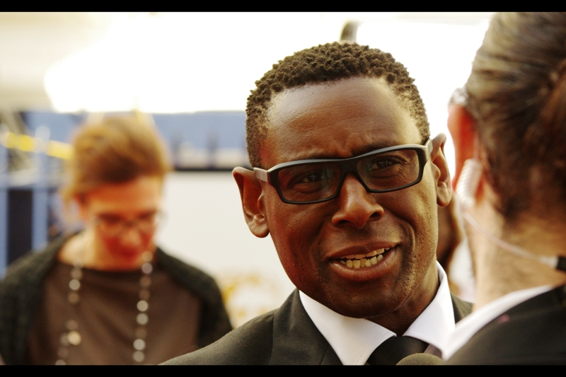 I recognise this man as he was doing interviews directly in front of me at  the Olivier Awards a few weeks back , however I don't know his name, and opening Getty Images at home is impossible, and that's because my TalkTalk internet connection hangs by the kind of thread that makes me count down the seconds til I tell those thieving clowns their service sucks since they took over from Virgin. Plus they're charging me more (and claiming they charge me less) because apparently lying is allowed these days?  (edited to add : David Harewood)