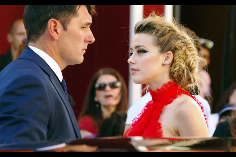 """""""Staring contest. Right here. Right now"""".  Amber Heard is best known for being sensationally and spectacularly pretty, and sadly not being my girlfriend while I continue to hope Charlize Theron reconsiders my years-long silent pining after her as evidence that we should be together."""