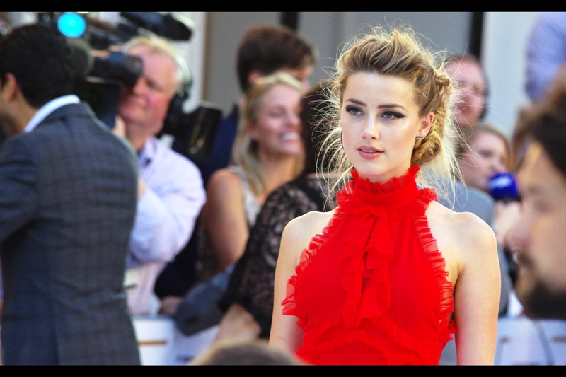 Amber Heard is one of those people who is so staggeringly beautiful I have trouble remembering what she looks like because there appear to be no actual flaws or imperfections that make her face otherwise memorable. ..... I suppose I should have saved this pretty awesome compliment for somebody not currently married to Johnny Depp....