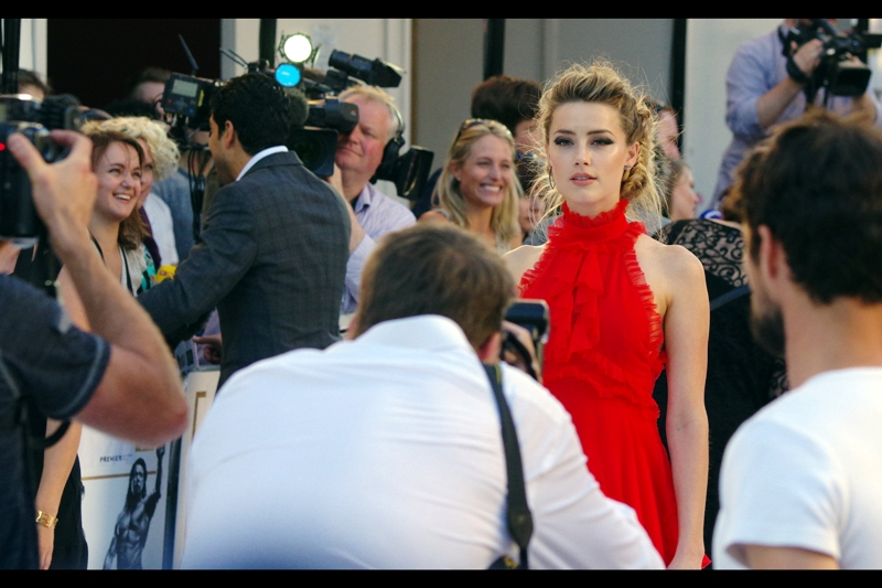 Amber Heard's gaze passes beyond the VIP Paparazi cordon and finds my camera. My reflexes are fast enough to take the photo, but not fast enough to put down the camera and make *actual* eye-contact. Being a photographer is sometimes all about horrific sacrifices. (although fortunately I have the photo to remind myself of that sacrifice).
