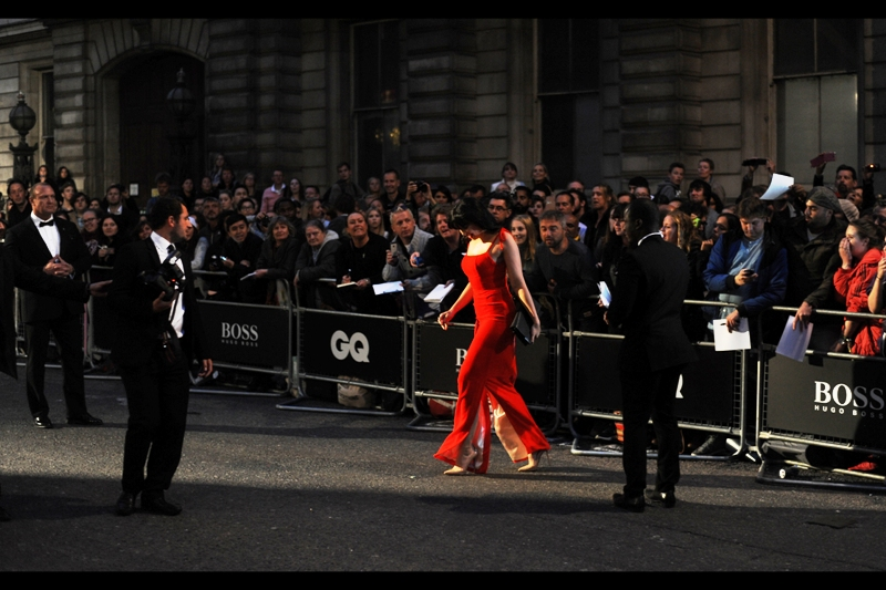 """Another woman wore red to this thing? I'm leaving""  Daisy Lowe heads for the Paparazzi cordon, hoping nobody noticed."