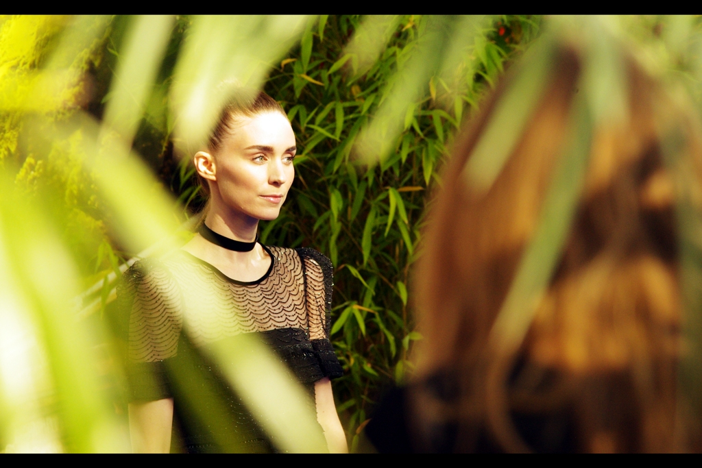 Rooney Mara goes crazy and headbutts a couple of photographers. Like.. in her mind. She's certainly got 'enigmatic/murderous smile' going for her.