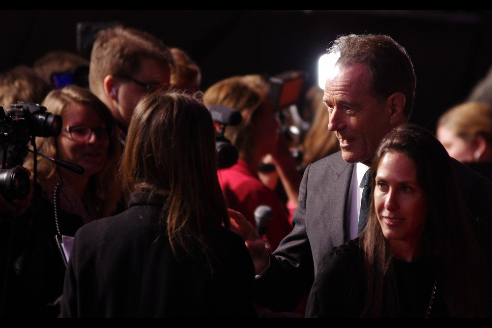 If this journal lacks Bryan Cranston photos, it's mainly because he's surrounded by a half-dozen entourage orbiting around him, and a constant stream of people flowing past him, and his decision to not sign autographs or even acknowledge our area.