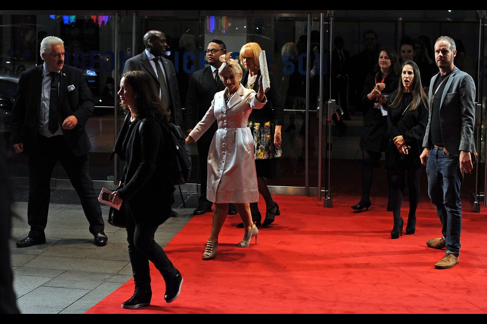 """""""Catch ya l8tr, beyotches"""" -  Dame Helen Mirren didn't say that... but I think that's the gist of her gang sign farewell as the stars exit the cinema about 15mins after entering."""