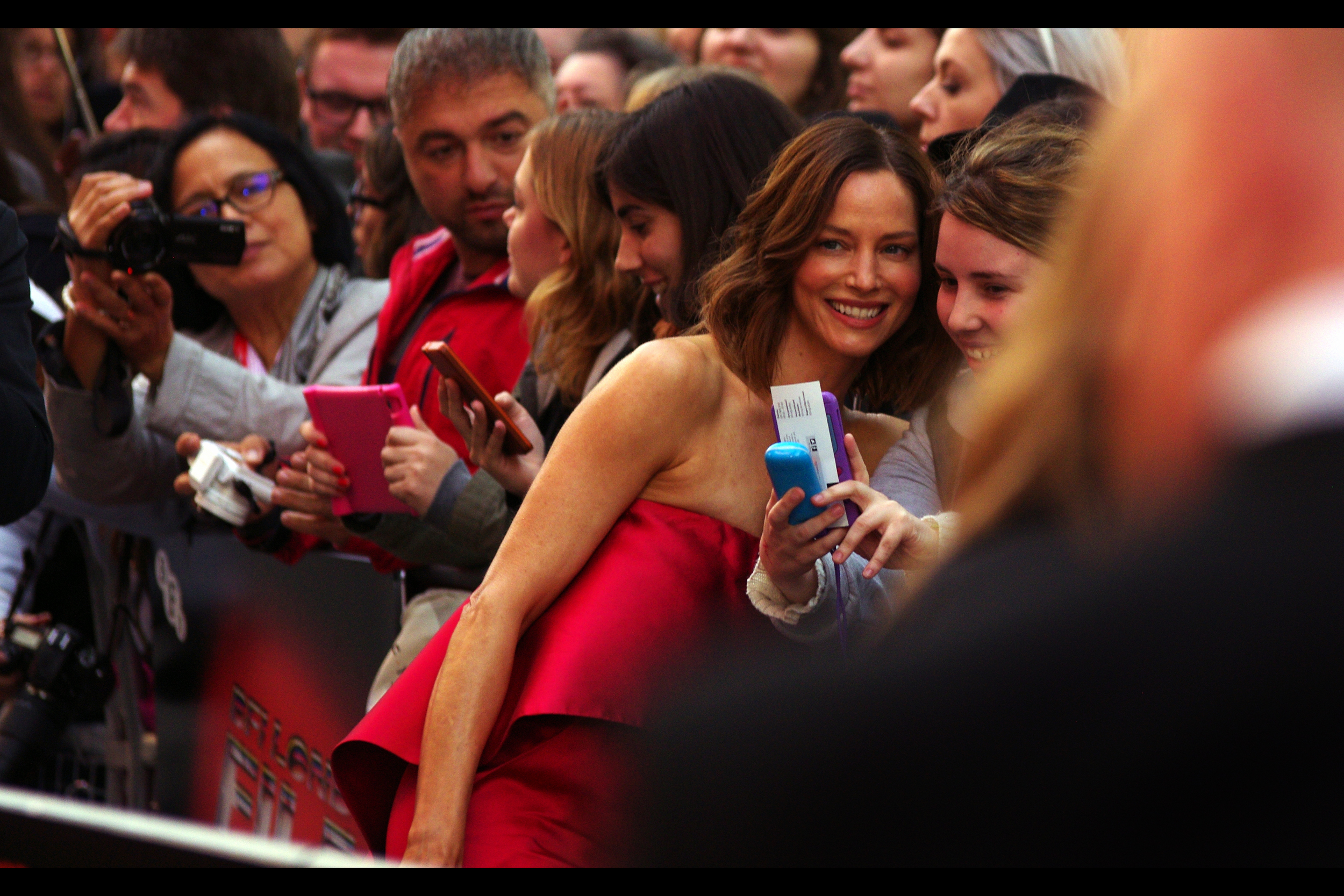 """And I took these photos when I was in Crete two years ago. That was a good holiday"".  Sienna Guillory may or may not be paying attention to your holiday photos at this premiere."
