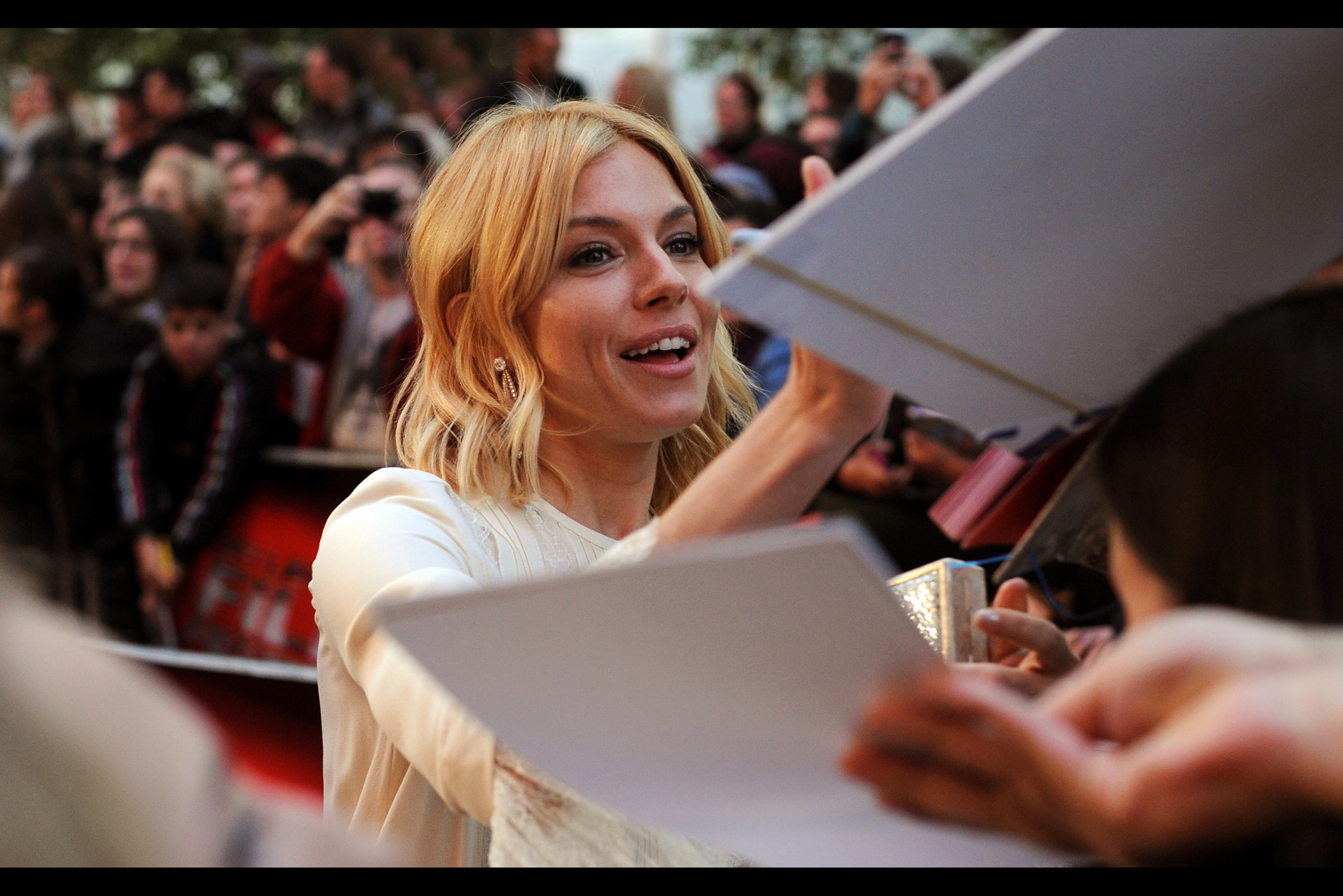 I have no idea what to write for this photo, however if the crush for Sienna Miller's autograph is about 1/3 of what I'm going to be experiencing when Tom Hiddleston arrives, I'm going to need to make sure my Australian Medicare card really is valid in the UK.