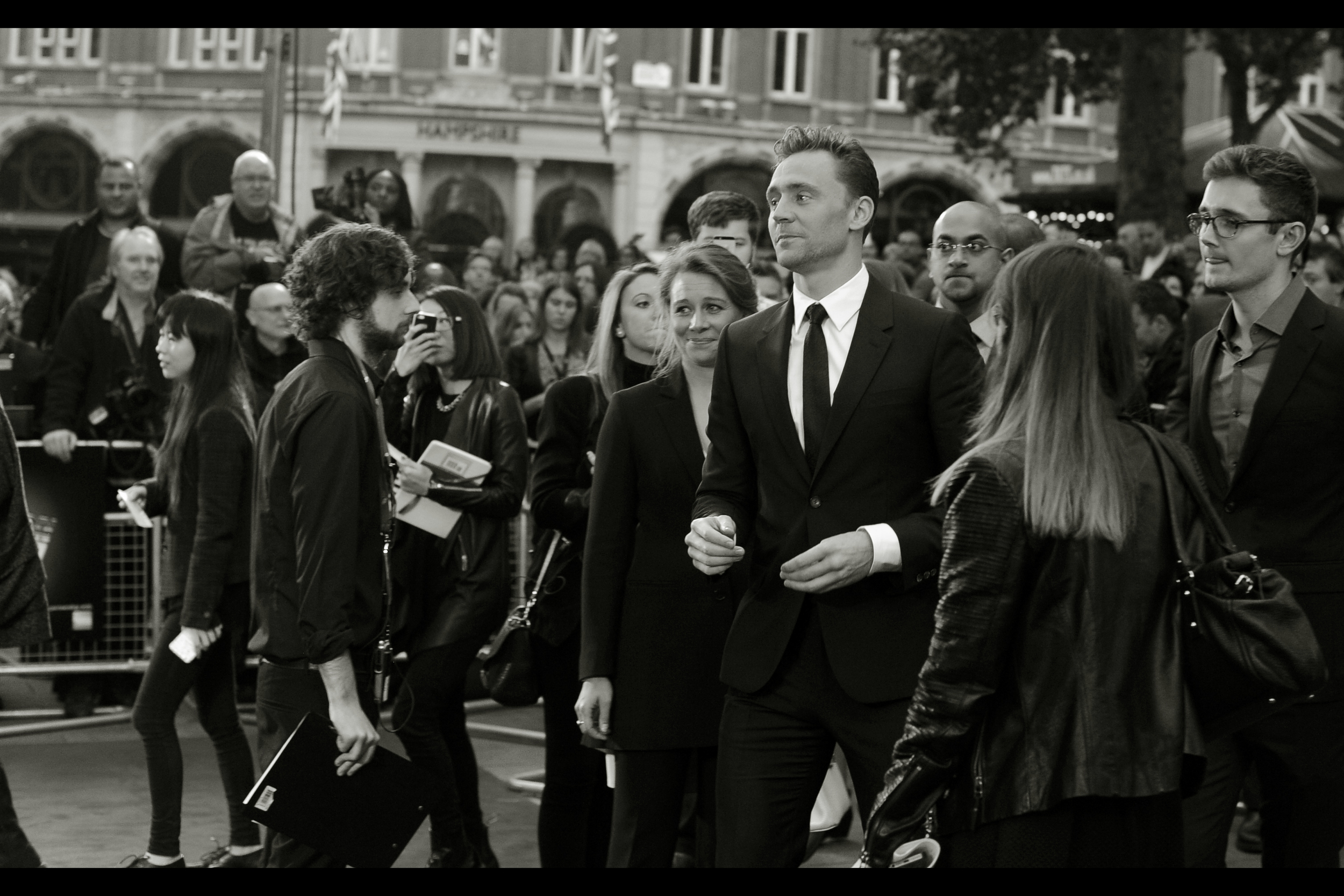 Well... it's finally happened. Tom Hiddleston has arrived. The guy on the left wth the clipboard is obviously immune to the wave of estrogen hanging above the crowd....
