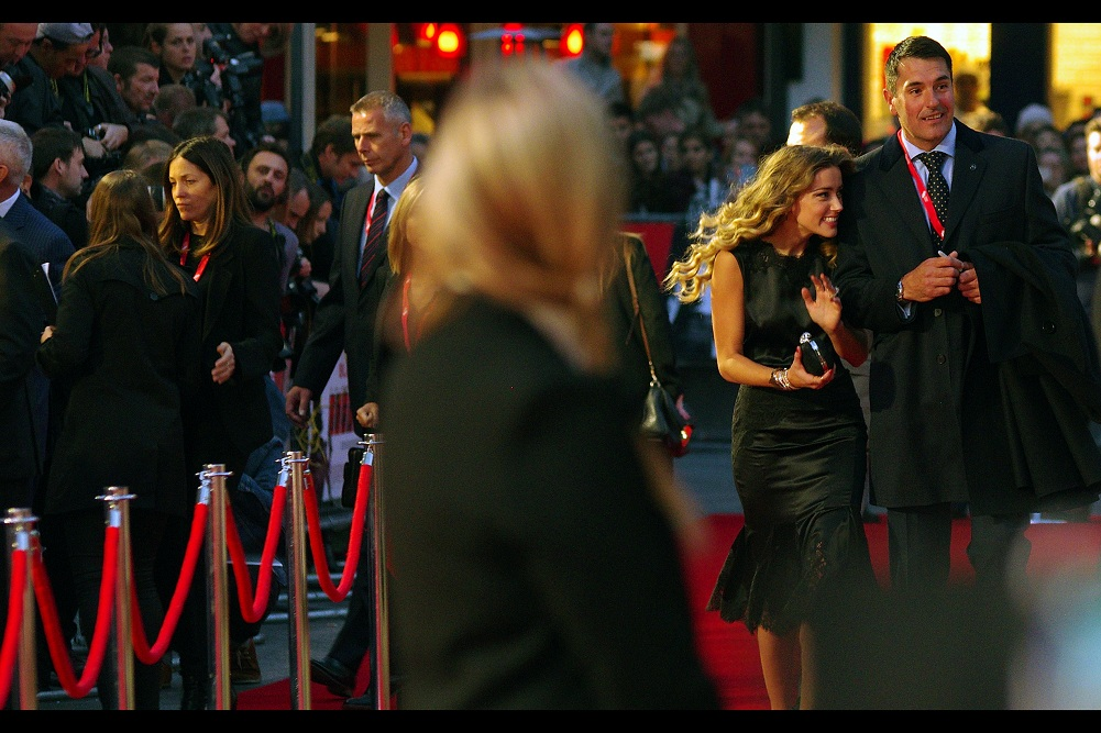 I'm puzzled.... I thought I'd established a mere two photos ago that if Amber Heard wanted anybody who was not her husband to accompany her down the red carpet, it would be me (no?) - well... sadly this person she's hanging on the arm of is not even remotely me.