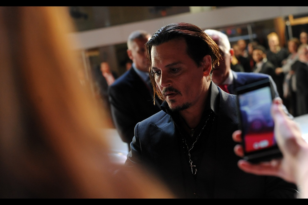 """Heaven help me, I appear to have taken leave of my senses""  And lo, to the confusion of me, certainly, Johnny Depp stepped away from the Mercedes and signed a little more."