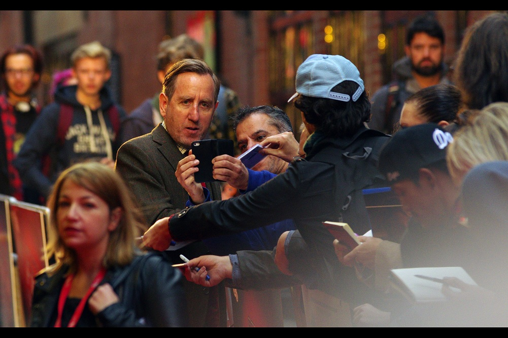 """""""She's a bit old... and there are nine flights of stairs. Also she might have gone down to the shops for cigarettes. You're happy to wait, though?""""  Michael Smiley has a list of imdb credits that's long and highly varied, though I'll be honest I don't remember him from anything I've seen (eg.  The Worlds End )"""