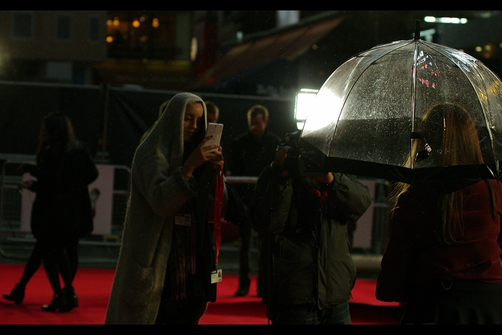 .. .and then it started to rain, making things even MORE serious and real. (And I think this lady is using a Samsung phone at an event celebrating the founder of Apple.... so it's possibly getting Seriously and DANGEROUSLY real.)