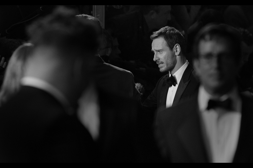 """""""I""""m not sure how much of the screaming is for me and how much is for Kate Winslet, actually...""""  Michael Fassbender arrived some time ago, but spent much of it in the darker, murkier parts of the barriered corridors of the premiere, signing for autograph dealers and soothsayers and gypsies.."""