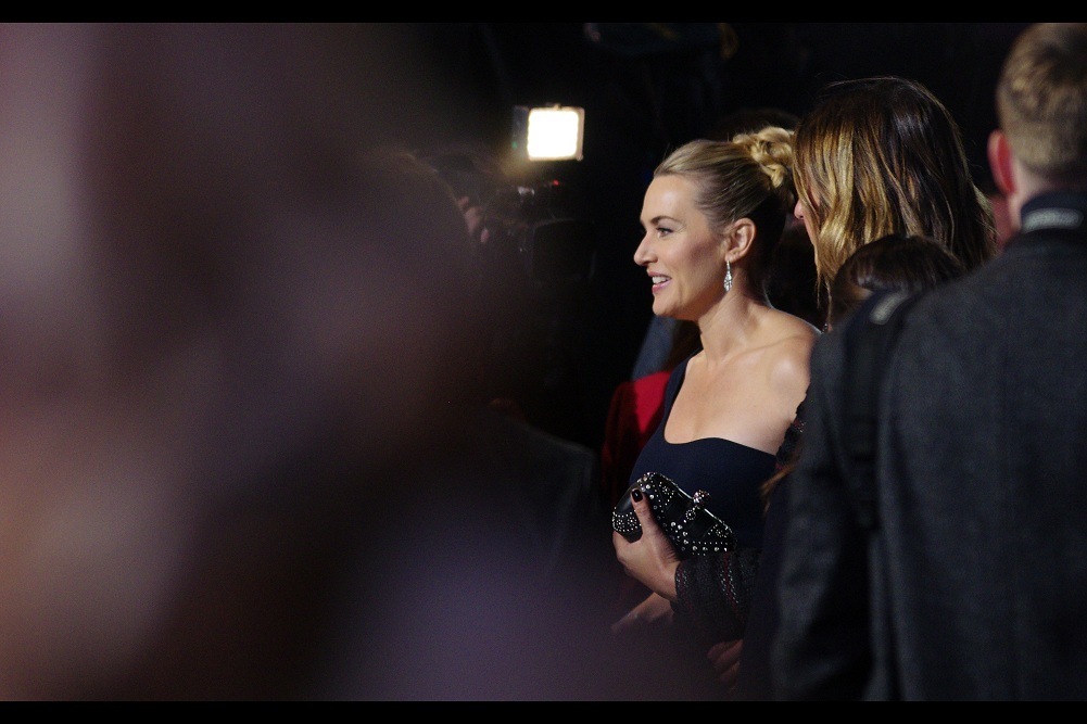 """""""Do you really need to be putting your hand there??""""  Honestly... it took me more than several passing glances to figure out that the lady is clutching a handbag, not ... uh... Kate Winslet. In my defence, I'm really REALLY tired right now."""
