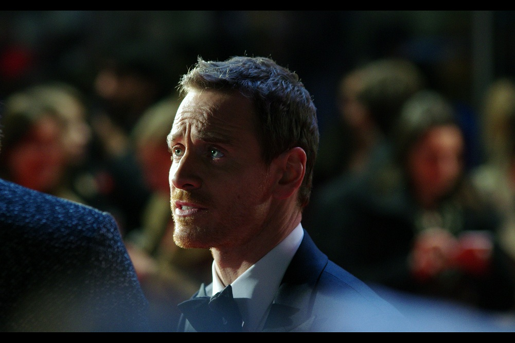 Michael Fassbender remains coy about whether it was his powers that got a guy out of a wheelchair, or merely the guy wanting an autograph more than he could recall his inability to walk.