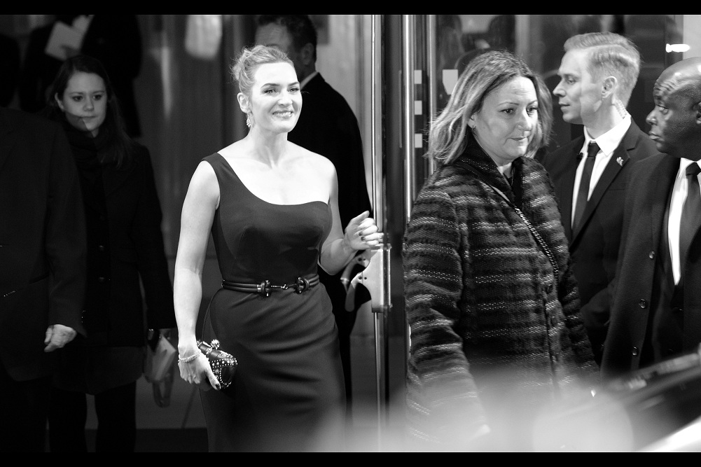 Kate Winslet oozes charm and grace... but ominously for the chance of me getting a meaningful glance / wave / air-kiss on camera, the pom-pom on the beanie of the girl in front of me begins to rise.. (note : not a euphemism)