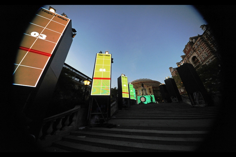 T-minus 26 hours. The statue in front of the Royal Albert Hall has been obscured by a large screen and a stage with two black amorphous shapes on it. Mysterious...