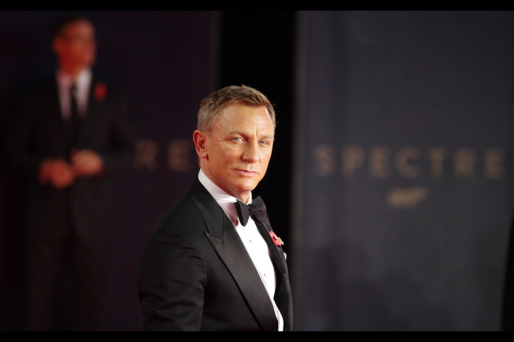 Daniel Craig recently expressed a reluctance bordering on the suicidal to playing James Bond a fifth time. But since those statements were made, he's been forced (possibly at gunpoint by the movie studio) to remember that, indeed, he loves playing the character.Can't get enough of it. Will fight you to the death to keep playing him. At least until the press tour for the movie finishes.
