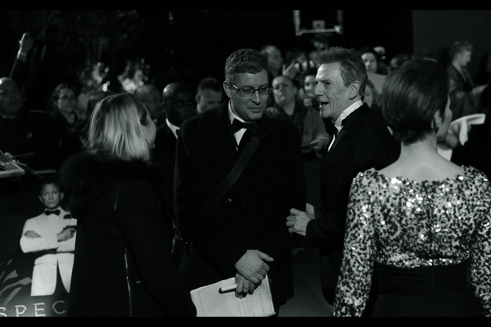 """""""How the hell did they recognise me in this crowd?""""  Jesper Christensen holds the rare distinction of having a role (albeit small) in each of the Daniel Craig bond films. He plays the enigmatic 'Mr White' in all of them."""