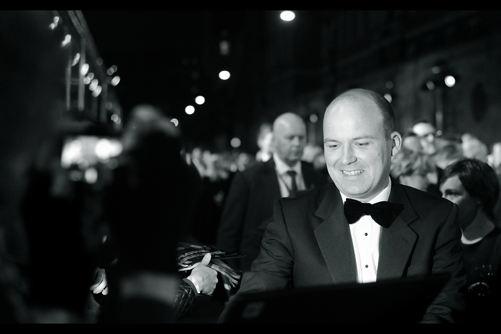 """""""I'm not supposed to accept gifts. 'Supposed To' being the operative phrase. That said, and with all due respect, what is it that you're handing me?"""" . Rory Kinnear has played the role of Bill Tanner in the last three James Bond films. (not to be mistaken for Biff Tannen in the Back to the Future films)"""
