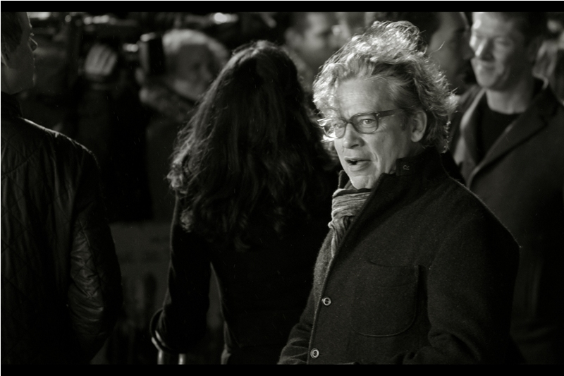 'This scarf is awesome. You'd better not post this photo in black'n'white and deprive people of the experience of seeing it'  Not in this movie or associated with it, but nonetheless one of the lucky people getting to see it : director Dexter Fletcher (also spotted in the crowd, director Sam Mendes)