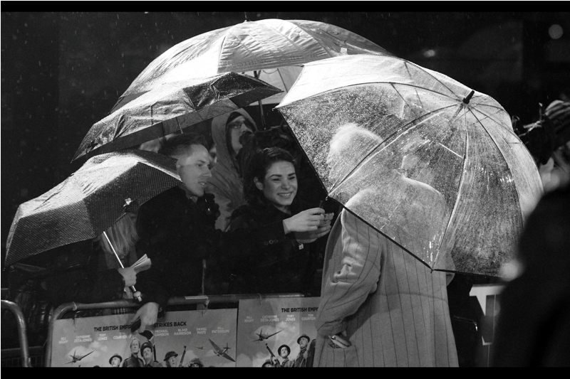 """I'd actually prefer not to answer any questions.... mostly I just came over to congratulate you on this wonderful umbrella igloo you've created"""