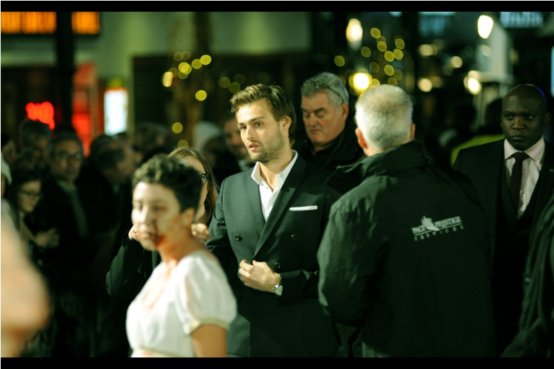 """""""Not so worried about the women staggering around in the white dresses.... however could you check on the guy behind me on the far right? He's worrying me a bit"""".  Douglas Booth has arrived, to the screams of women who are rehearsing for Matt Smith."""