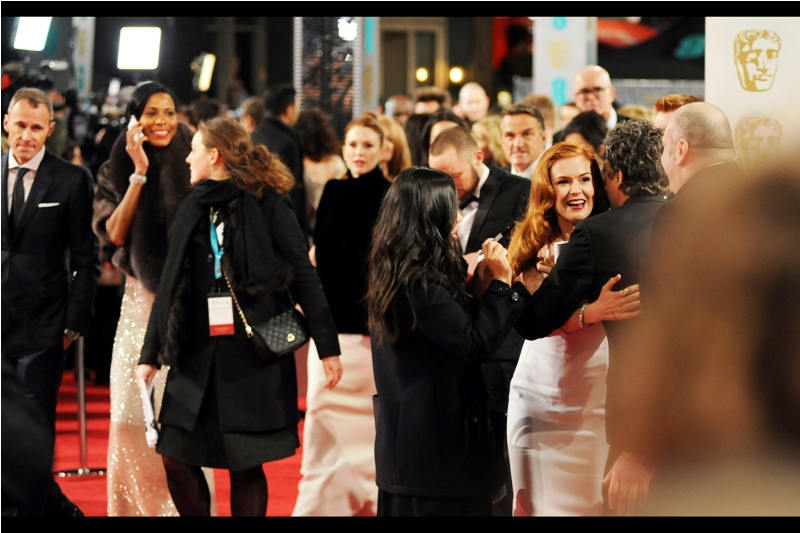 """At right, Sacha Baron Cohen's wife Isla Fischer hugs Mark Ruffalo, reminding me that they were cast-mates in the rather excellent (I feel) """"Now You See Me"""", a sequel to which she's sadly not in."""