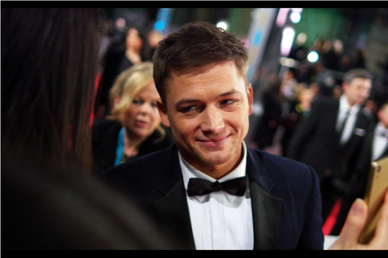 """""""Is that your hand in my pocket or am I... wait.... how does that quote go?""""  I think one of the Chinese girls got Taron Egerton to sign HER PHONE. And from what I can tell it was the front screen she got signed."""