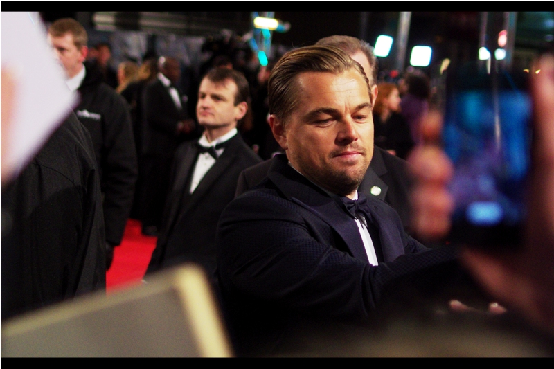 Leonardo DiCaprio signs in our area, and am suddenly touched by more people than I'd anticipated this Valentines Day as everyone around me wants something signed by the man, and I'm seemingly in the way. Or really good looking, I suppose.
