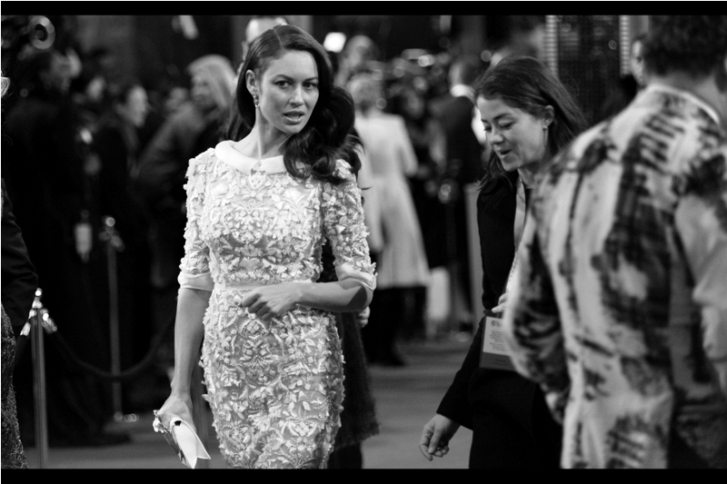 Actress Olga Kurylenko's dress is like a combination lace doily and one of those magic eye patterns that has a hidden image in it. She's best known for being the female lead in  'Quantum of Solace ' (a terrible premiere but both she and I attended), and she was also in  'Oblivion'  .